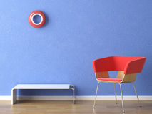Red chair on blue wall. Red chair, lamp and table on blue wall Stock Photo