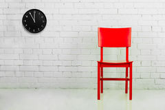 Red chair with clock Royalty Free Stock Image
