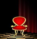 Red chair in a dark room Royalty Free Stock Photography