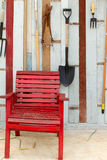 Red chair. In front of the old wooden walls. Royalty Free Stock Image