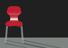 Red chair on gray backgrounds Royalty Free Stock Photo