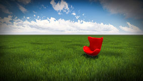 Red chair. Green meadow. and sky cloud Stock Image