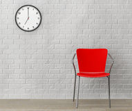 Red Chair with Modern Clock Royalty Free Stock Image
