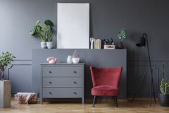 Free Red Chair Next To Grey Cabinet In Living Room Interior With Mock Stock Photos - 124787973
