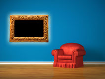 Red chair with picture frame Stock Photo