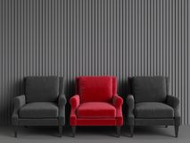 A red chair among pink chairs on grey backgrond Stock Photo