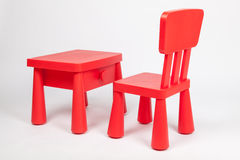 Red chair and red table for children in kindergarten preschool classroom Royalty Free Stock Images
