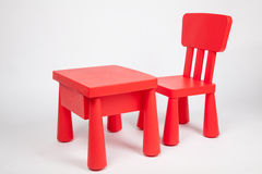 Red chair and red table for children in kindergarten preschool classroom. Red chair and red table for children in preschool classroom royalty free stock photography