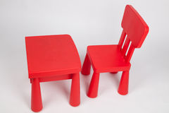 Red chair and red table for children in kindergarten preschool classroom Stock Images
