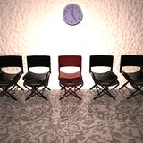 Red chair in row of black chairs Royalty Free Stock Photos