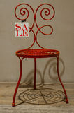 Red chair on sale. Red chair with on sale tag attached Stock Photo