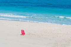 Red chair on the sand Royalty Free Stock Image