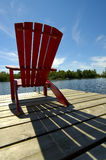 Red Chair Shadow On Deck Stock Photo