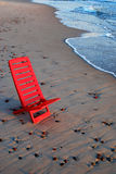 Red chair on the shore. Of Baltic sea. Travel Europe stock photo