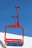 Red chair of ski lift Stock Image