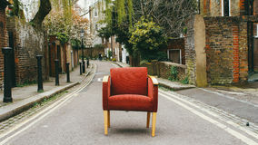 Red chair on street