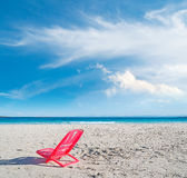 Red chair under clouds Stock Photography