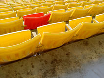 Red chair in yellow chair Royalty Free Stock Image