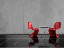 Red Chairs. Modern red chairs on a shiny black stone floor Stock Photos