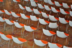 Red chairs. In empty conference room modern and sober royalty free stock photo