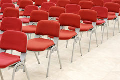 Red chairs. In an auditorium Royalty Free Stock Photography