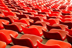 Red chairs. Curves,waves and parallel lines formed by red plastic seats and  chairs in a stadium Stock Images