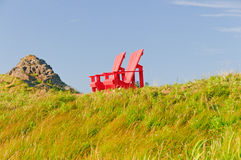 Red Chairs against a Blue Sky Royalty Free Stock Photography