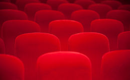 Red chairs in the auditorium. Red chairs in the empty auditorium Stock Photo