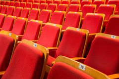 Red chairs in the auditorium of the theater or concert hall royalty free stock photography