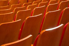 Red chairs in the auditorium of the theater or concert hall stock image