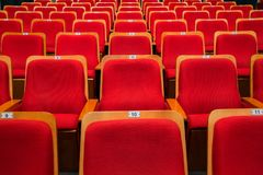 Red chairs in the auditorium of the theater or concert hall royalty free stock photo