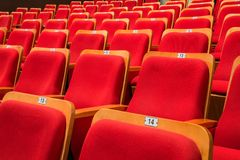 Red chairs in the auditorium of the theater or concert hall stock photography