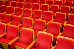Red chairs in the auditorium of the theater or concert hall stock photo