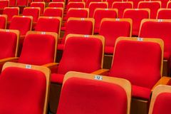 Red chairs in the auditorium of the theater or concert hall stock images