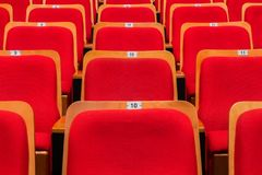 Red chairs in the auditorium of the theater or concert hall stock photos