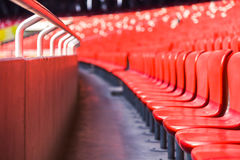 Red chairs bleachers in large stadium Royalty Free Stock Photography