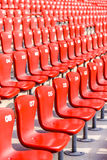 Red chairs bleachers in large stadium Stock Photos