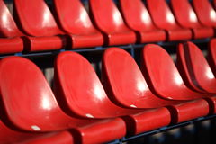 Red chairs bleachers Stock Images