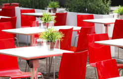 Red chairs cafe. Empty outdoor cafe with red chairs Royalty Free Stock Photos