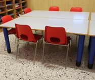 Red chairs in the classroom of a kindergarten. Without kids stock image