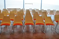 Red chairs conference. Red chairs in empty conference room modern and sober stock images