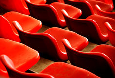 Red chairs and curves. Rows of red chairs in the stadium,beautiful curves ,waves ,pattern Stock Image