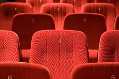 Red chairs on the empty cinema Stock Photography