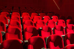Red chairs. On the empty cinema auditorium Stock Image