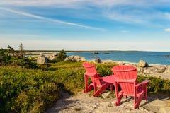 Red chairs facing Keji Seaside beach Stock Photography