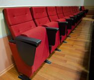 Red chairs in the hall Stock Photography
