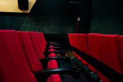Red chairs inside of a cinema Stock Photo