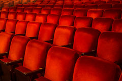 Red Chairs inside a Theatre. Rows of Red Chairs inside a theatre with copy space Stock Photo