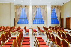 Red chairs and luxury yellow blinds stock images