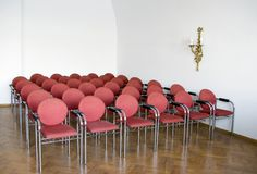 Red chairs in meeting room Royalty Free Stock Image
